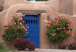 Pueblo revival with warm earthy tones set off by blue or green highlights.