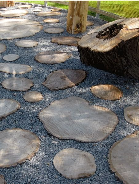 log slice patio pavers - this looks neat, but I reckon they'd be better as stepping stones with stuff growing around them