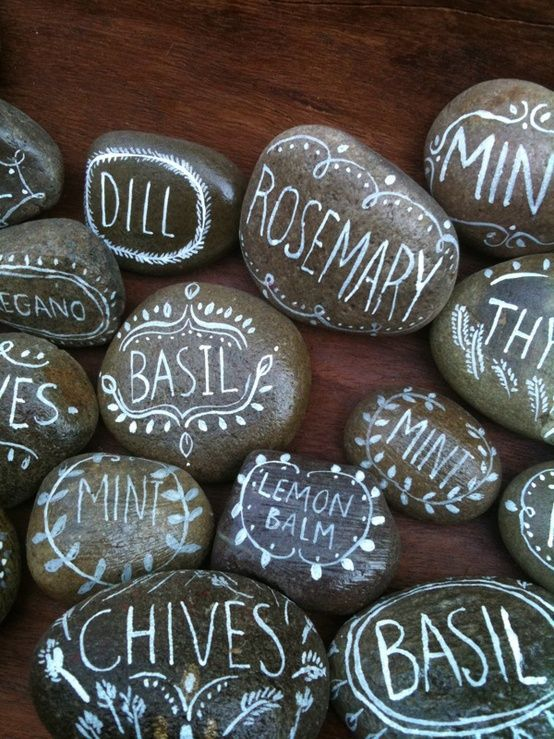 Painted rock plant markers.