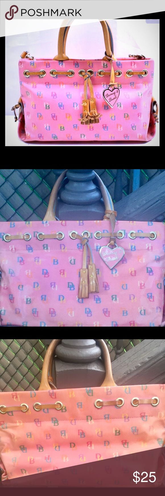 Dooney and Burke bag. this bag has a lot of life left in it! I would love to see it get a good home, it's so cute! It's coated with canvas,and leather handles, can go for a cleaning tho. I posted the pix above, if you guys have any questions please don't hesitate to ask, whoever purchases this is getting 2 bags, Yes I putting another D&B in their and yes it's authentic! 🤗happy poshing!  and thank u for stopping by!any questions? Just ask thank u! Medium sized bag! Multi colored canvas bag…