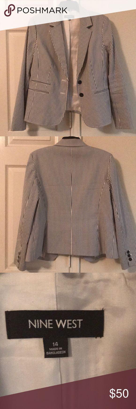 Seersucker blazer, dark gray/white, size 14 Dark gray/white striped (seersucker) blazer by Nine West, size 14 Nine West Jackets & Coats Blazers
