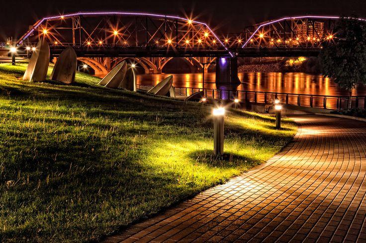 The lights of River Landing and the Victoria Bridge in Saskatoon