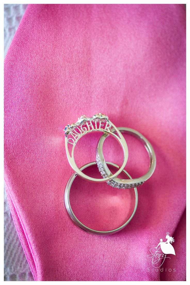 Bride's and groom's wedding rings and also a promise ring to their daughter