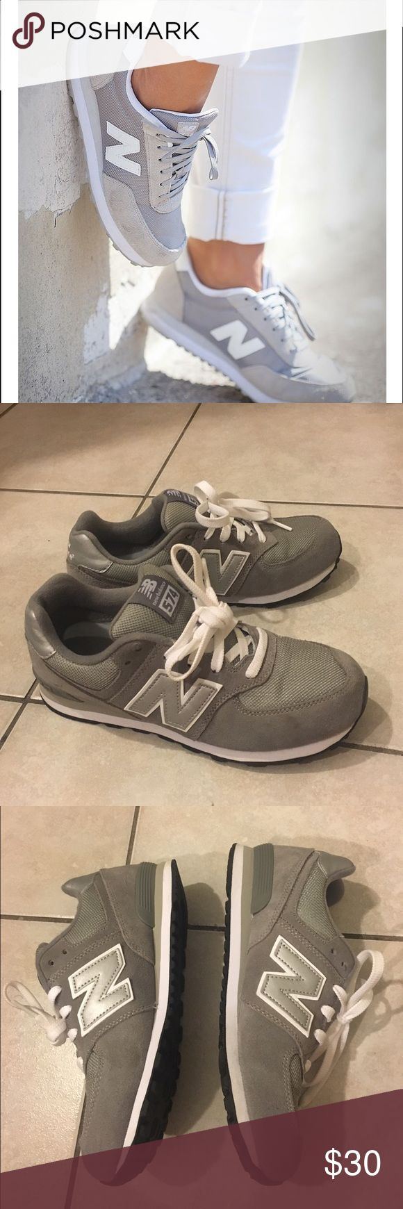Grey New Balance 574. LIKE NEW Great condition. Like new. Grey and white new balance 574's. Size 5 New Balance Shoes Sneakers