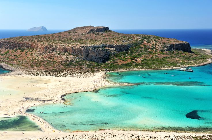 Balos Beach, Crete: Another of the most exotic beaches in Greece that's considered one of the finest in the Med, Balos lies in western Crete near Kissamo. Here the sand glistens pink and white, the water combines the most dazzling shades of blue and green, while the islet of Gramvousa with its Venetian castle adds a fairy-tale note to the scene.