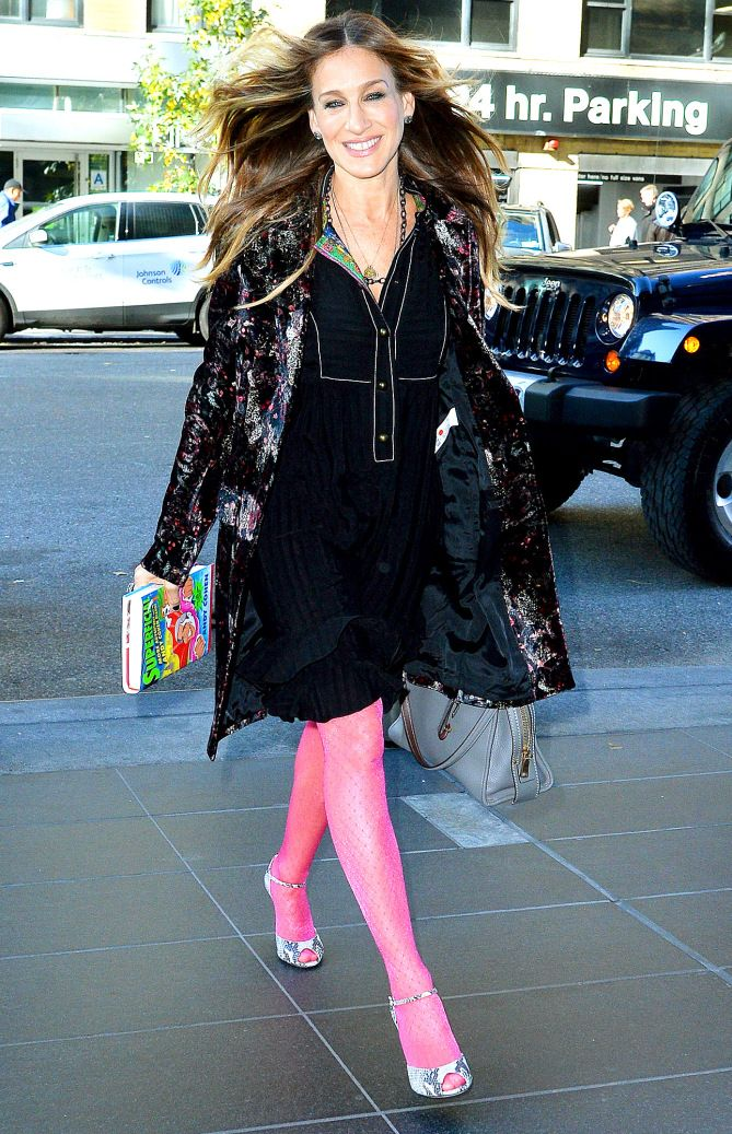 Sarah Jessica Parker in a black dress, floral coat and pink tights