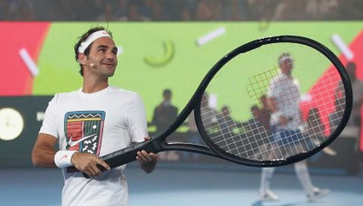 The Swiss is very, very fond of his Wilson racquet, at any size.