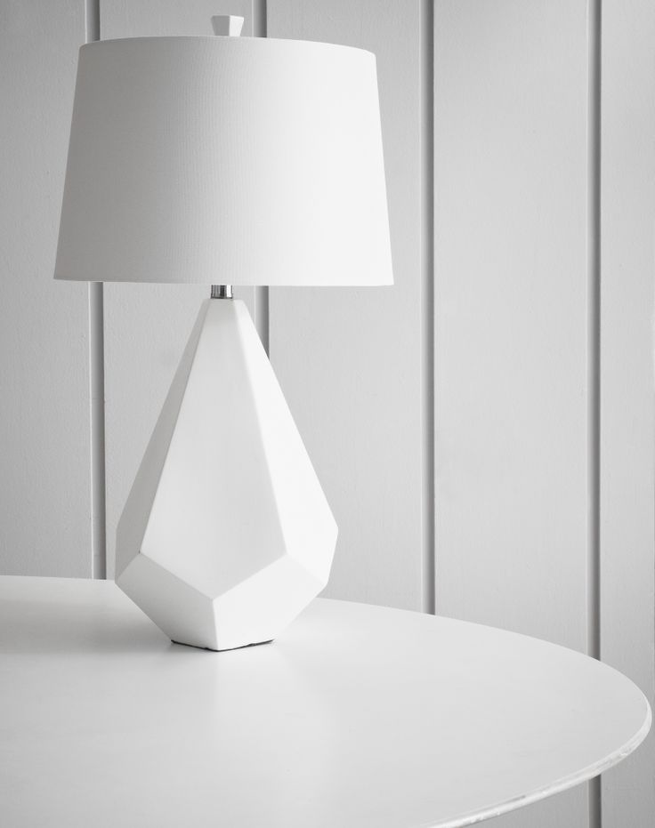 Surya lamp is sleek and modern in white with a geometric base.