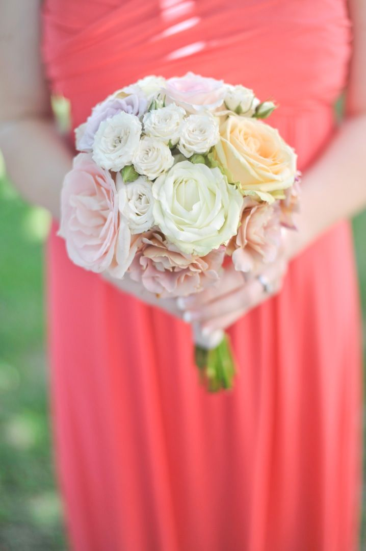 bridesmaids coral dress and bouquet