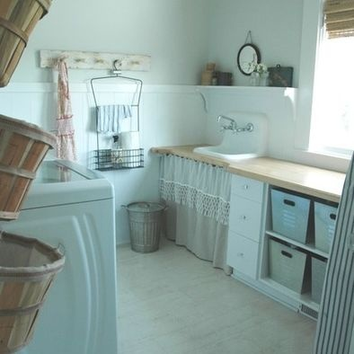 vintage farmhouse laundry room with ticking curtains