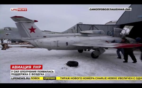 "Russian separatists push an Aero L-29 Delfin trainer/light attack aircraft from a hangar. They claimed to have several combat ready aircraft and helicopters. In reality all were from various museums, in bad condition and needed major restoration before being ready for combat. The Ukrainian government now claims to have destroyed them all anyhow by using a multiple rocket launcher BM-27 ""Uragan""."