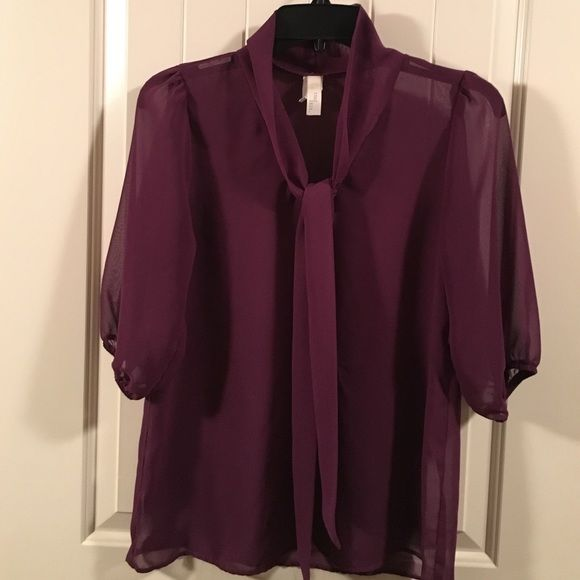 3/4 Sleeve Sheer Purple Blouse Gorgeous top! Great for layering because of the sheer material. Has a front tie that can be worn as a bow or just loosely tied. Tini Lili Tops Blouses