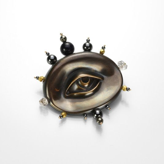 A collector's piece, this Gabriella Kiss brooch is a truly special! The oxidized bronze and 22K yellow gold eye is beautifully decorated with a perimeter of blue goldstone, pyrite, hematite and herkimer crystal beads. This little pin is all at once a conversation starter and a real delight! @quadrum