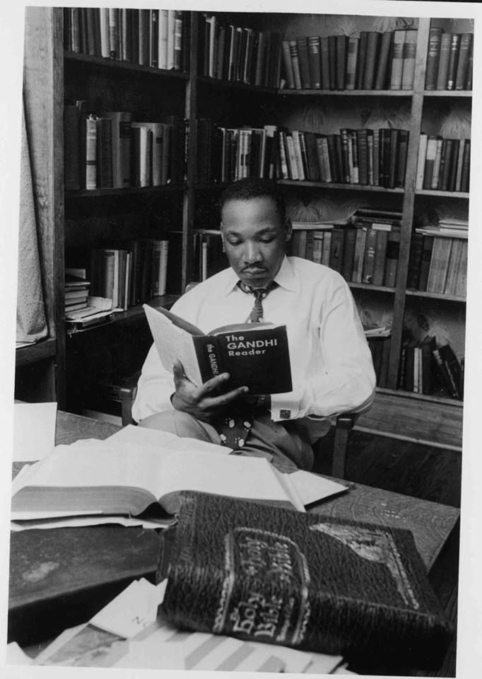 "MLK reading The Gandhi Reader with the Holy Bible in the foreground. ""An eye. Dr MartinsMahatma GandhiKing ..."