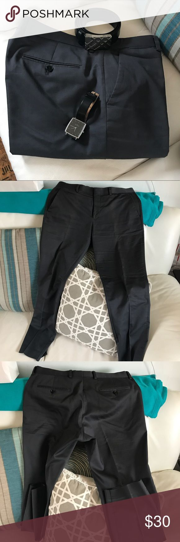 Express photographer pants Express photographer charcoal gray dress pants in really good condition, the only thing is that there is a pinkish line down the front at the crisp line. Not sure why this happened, my guess from the iron heat at the dry cleaners. Express Pants Dress