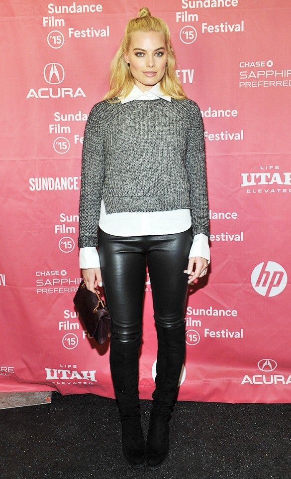 Margot Robbie in a Raquel Allegra pullover, Bruno Cucinelli leggings, and Stuart Weitzman boots