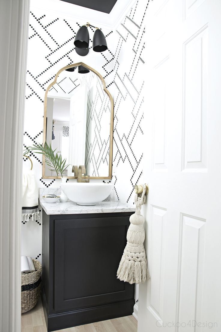 White and blue powder room features walls clad in trim molding framing - The New Gold Arched Mirror Is Here
