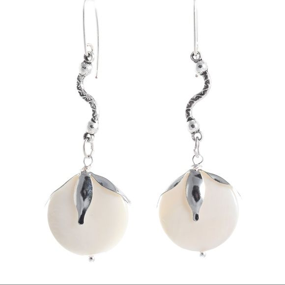 Blooming Seashells Earrings Make a subtle statement with these elegant pearl white seashell earrings wrapped in silver plated buds. Length: 6 cm (2.36 inches) Nickel free copper with silver plating Size of seashells: 20mm each Jewelry Earrings