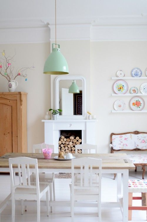 Pure white base, wooden table, crocheted stool, stacked wood, mint green light, plate display