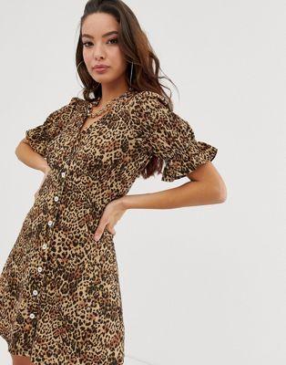 4d4b9a8ea10 ASOS DESIGN button through rib tea dress with puff sleeve in animal print