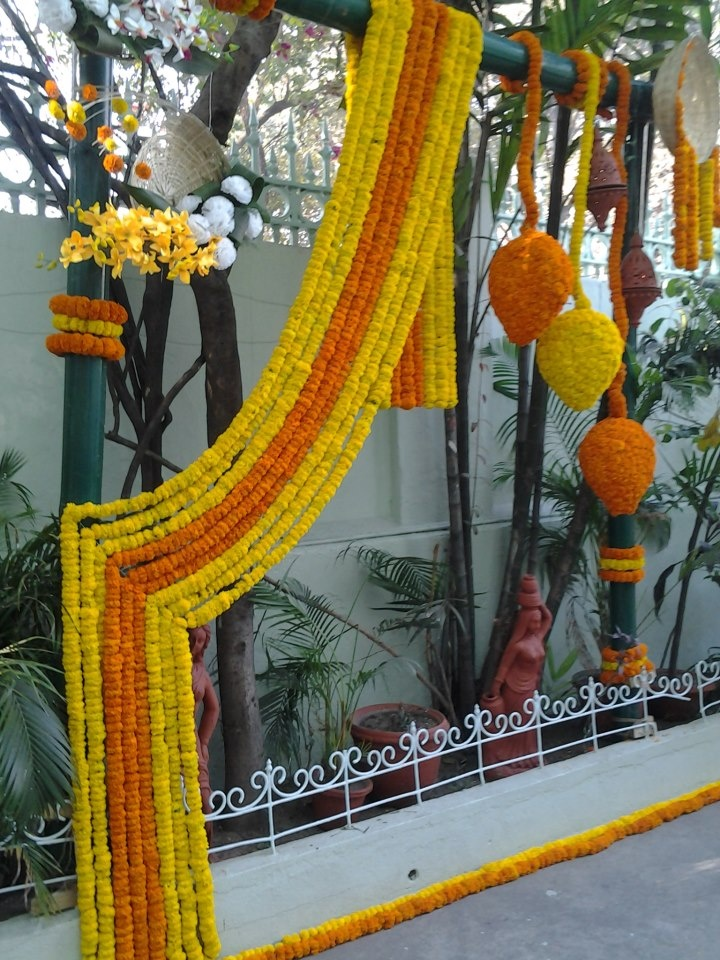 "Decorating the wedding venue with ""gandha"" garlands"