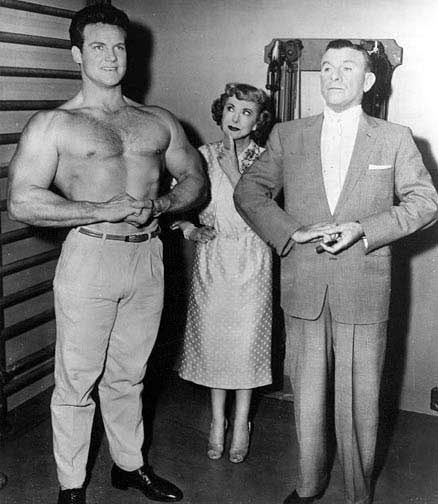 "Steve Reeves flexing on ""The George Burns and Gracie Allen Show."""