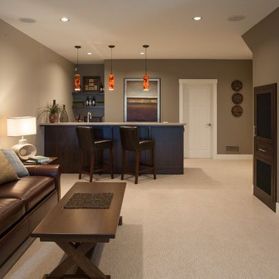 The gas fireplace in this basement living room is flanked - Basement living room ideas ...