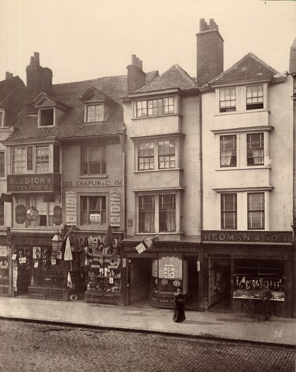 A woman lingers in front of the butcher in Borough High St, Southwark, London