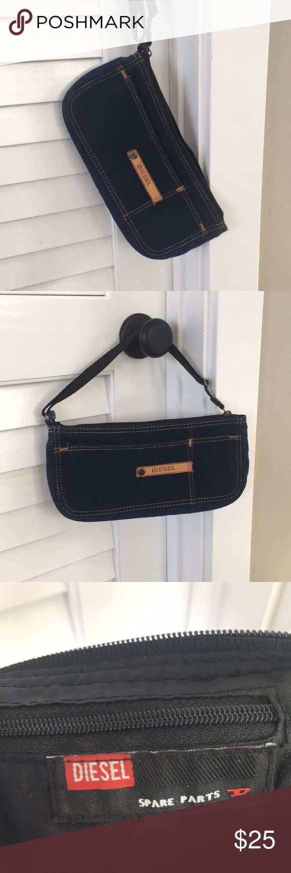 Diesel Clutch in Navy Blue Corduroy Diesel clutch in navy blue. Gold stitching black strap. Used once or twice. No visible wear or defects. Comes from a pet-free, smoke-free home. Diesel Bags Clutches & Wristlets
