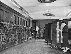 Betty Snyder (foreground) programs ENIAC in the BRL building 328. (U.S. Army photo). ENIAC was the first Turing-complete general purpose programmable computer.