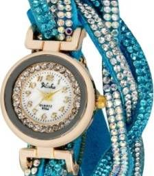 Sky Blue Crystal Shimmer Modest Analog Watch - For Women Add Style and grace when you pair this beautiful watch with casual and formal attire. Key Features: Dial Color: White Dial Shape: Round Strap Color: Dark Blue GENERAL: Mechanism:Quartz Type:Analog Series:Modest Style Code:Crystal Shimmer Dark Blue Ideal For:Women Occasion:Casual Power Source:Battery Powered Novelty Feature: Crystals Studded on Bezel BODY FEATURES Dial Shape:Round Box Material:Cardboard Strap Color: Dark Blue Strap…