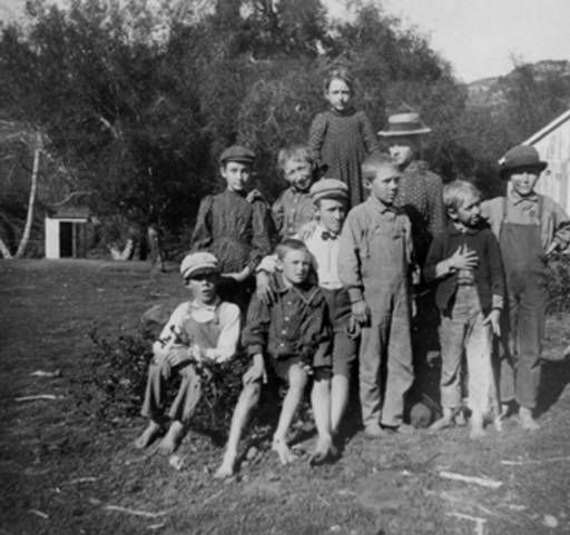 Little Red School House at the mouth of Greenleaf Canyon and Topanga Road in 1903. Back row from left: Mable Greenleaf, Tom Cheney, Bessie Greenleaf, Ceola Greenleaf. Front row: two on the left unidentifed, Harry Greenleaf, Leland Goebel, George Cheney, Winfield Goebel. Topanga Historical Society. San Fernando Valley History Digital Library.: Topanga Road, Red School, Mouth, Tom Cheney