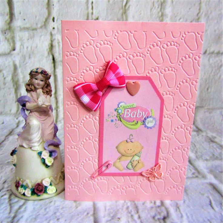 Lovely pink new baby girl card with footprints, bow, butterfly and heart.  Free postage