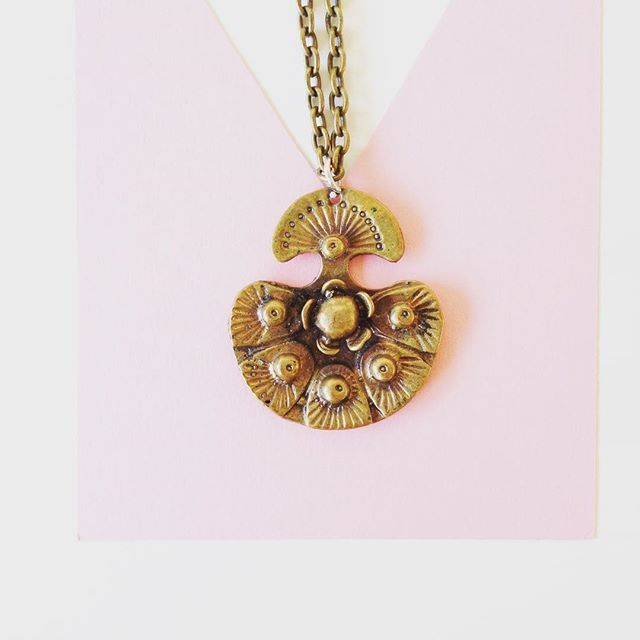 A bronze pendant by Finnish artist and goldsmith Seppo Tamminen made in 1970s .