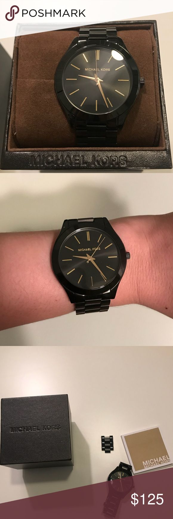 Michael Kors watch Gorgeous black Michael Kors watch with gold details. In great used condition. Battery is currently still working. I did remove a few links for my small wrist, but I will include the extra links that were removed. They can easily be added back. I will also include booklet and box. No trades please. Reasonable offers welcome! Michael Kors Accessories Watches