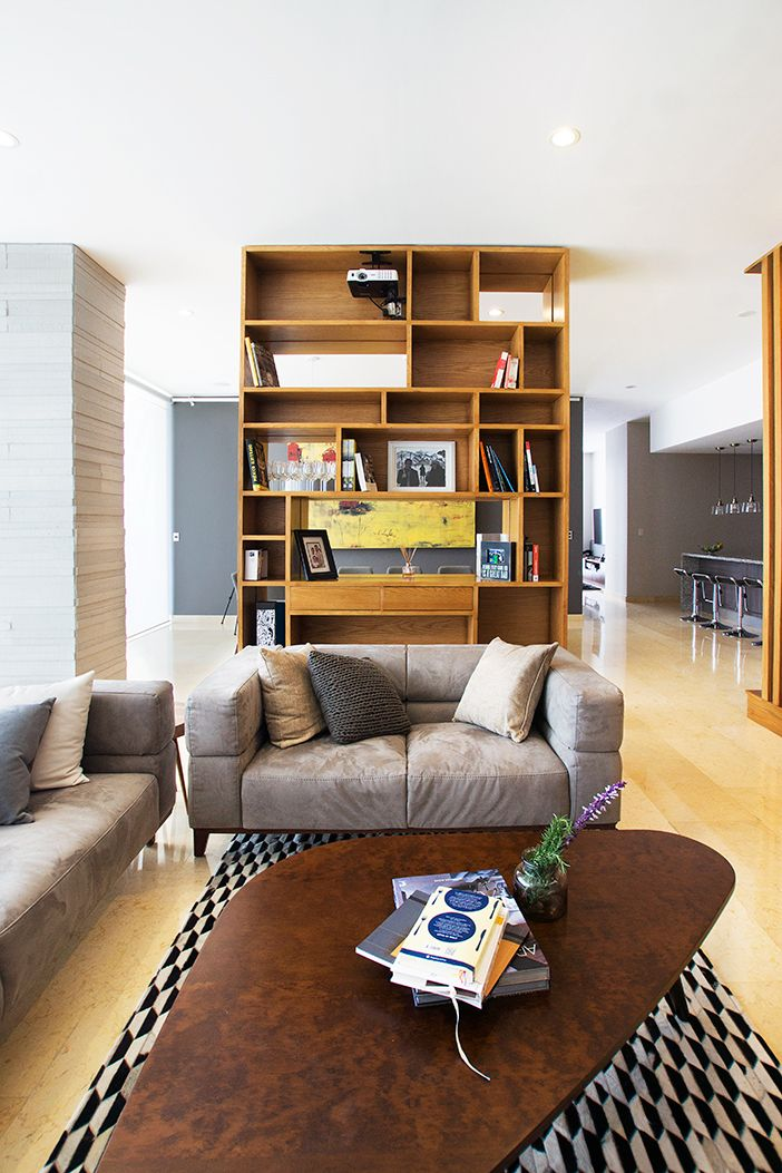 Penthouse HT | Dionne Arquitectos | #bookcase #penthouse #wood #armchair #livingroom #indoor #design #interior