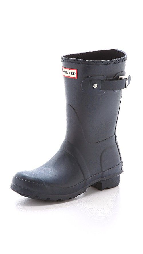 Hunter Boots Original Short Boots   A shorter version of the original Hunter wellies. These rubber boots are styled with a brushed buckle strap detailing the top line. Woven nylon lining lends extra warmth, and a cushioned footbed offers comfortable wear. Lug sole. Fabric: Rubber. Imported, China. This item cannot be gift-boxed. Note: High-quality natural rubber may release white marks, which can be wiped clean. Measurements    Heel: 1in / 25mm Shaft: 10.25in / 26cm Circumference: 14.5in…