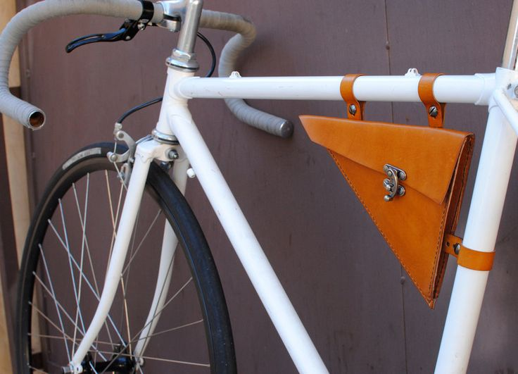 I maybe need this for me bike!  Leather Bicycle Bag (Triangle Bag). $75.00, via Etsy.