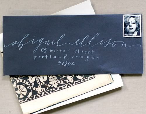 Calligraphy is adorable.  White ink on black envelopes, what a great idea!