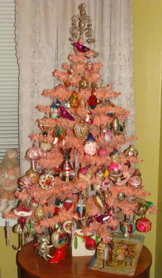 Pink Feather Tree with Antique Glass Ornaments from a private collection in Missouri  http://www.hometraditions.com/antique_christmas_in_missouri_s/1952.htm