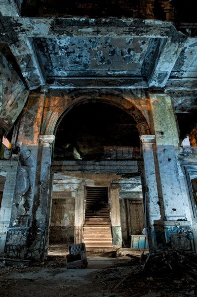 The interior of Gary Union Station, vacant for more than 5 decades, is considerably more dilapidated than the exterior, which is in remarkable shape. Lit by ambient city lights, plus a hand-held flashlight from behind the camera. Jon light painted the staircase from both sides as well.