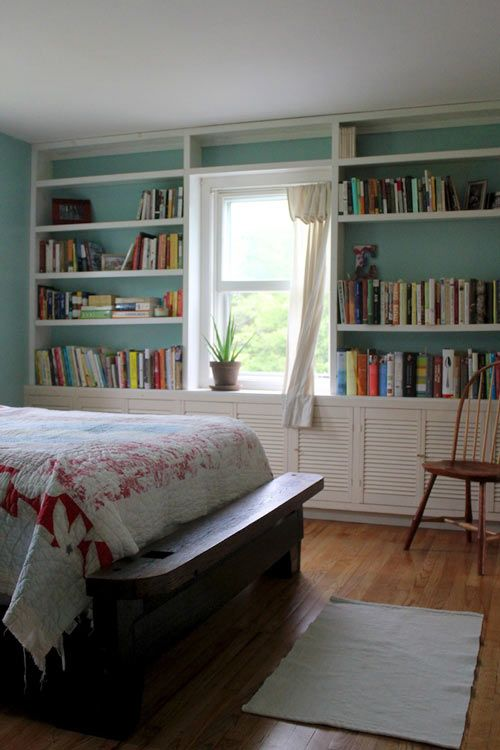 love the bookshelves, cabinets, window, window seat, white on colored wall