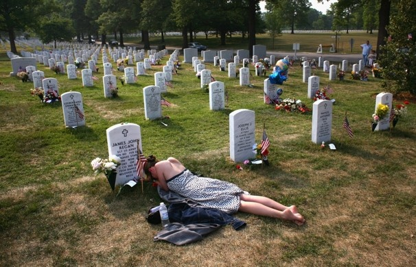 Mary McHugh mourns at the grave of her fiance, Sgt. James Regan, at Arlington National Cemetery.