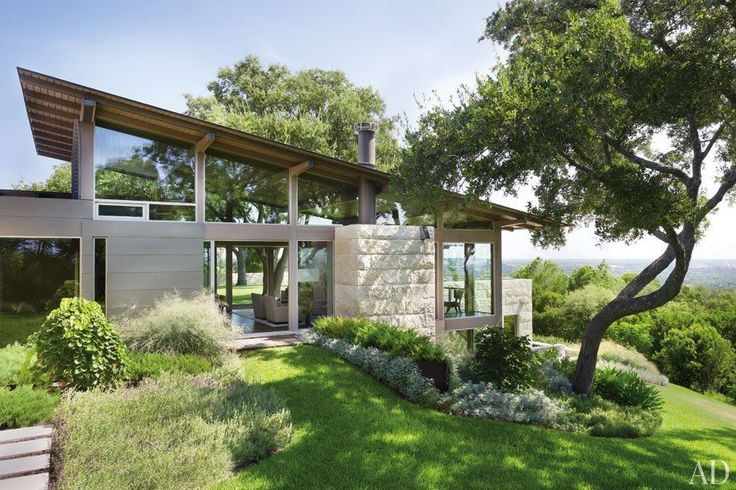 Ted Flato and Karla Greer of Lake | Flato Architects devised Hillside House, a two-story home partially submerged in its steep plot in Austin, Texas.