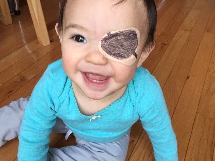 This tender father decorating the eye patch his little ...