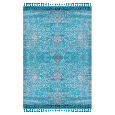 With its bold hue and faded damask design, this tasseled turquoise rug adds texture to bare floors and is a great way to refresh a tired scheme.  ...