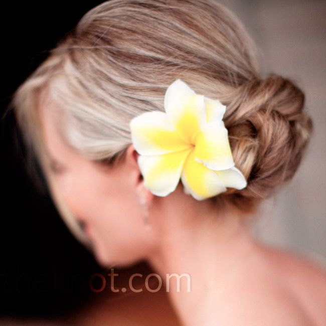 A Casual Wedding in Maui, Hawaii - The bridesmaids all wore their hair in low chignon buns with a single flower.