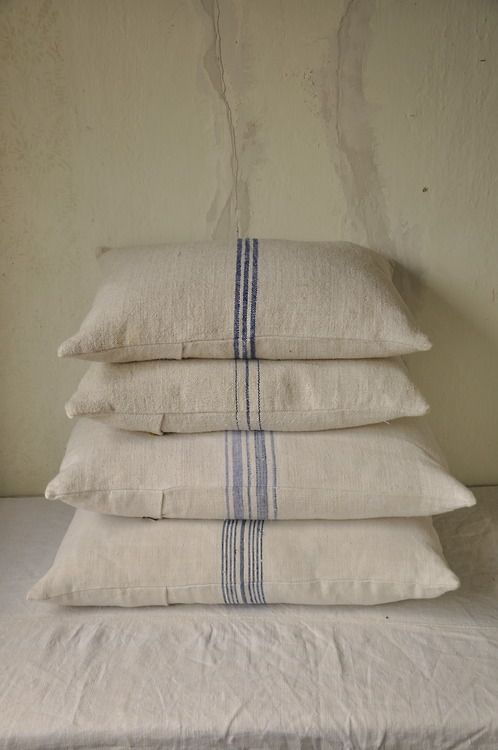Stack of linen grain sack cushions by Beyond France in House renovation photo shoot