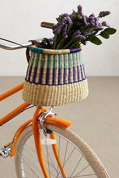 curtain rod on wall -- and three of these hanging from it.  Tonal Weave Bike Basket #anthropologie