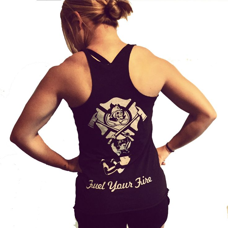 """This female firefighter fitness tank top features the female Fire and Fuel Apparel logo on the left chest. We added a female athlete hanging from the integrated F's in the image. The back has our skull and crossed nozzle logo in a center of a maltese cross. From the two crossed axes is a female firefighter athlete. As always find the things that """"Fuel Your Fire"""" the burns within you!  Our Fueled To Be Fit tank top"""